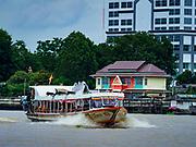 20 HULY 2017 - BANGKOK, THAILAND: A Chao Phraya Express Boat, a sort of riverine bus that takes commuters in and out of Bangkok on the Chao Phraya River as it flows through Bangkok.       PHOTO BY JACK KURTZ