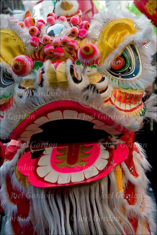 Chinese Lion Dancers, faces Chinese Americans in the parade demonstrating their ethnic pride along Mott  Street in Chinatown in lower Manhattan before the start of the Lunar New Year and the start of the Year of the Tiger.