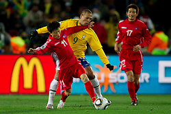 Korea's Mun In Guk  vs Brazil's Luis Fabiano during the 2010 FIFA World Cup South Africa Group G match between Brazil and North Korea at Ellis Park Stadium on June 15, 2010 in Johannesburg, South Africa.  (Photo by Vid Ponikvar / Sportida)