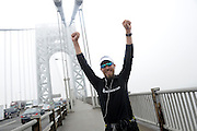 Ultra-marathon runner Daren Wendell celebrates as he runs across the George Washington Bridge on Friday, April 10, 2015, in New York, marking the 100th consecutive day of his cross country journey. Wendell departed from the Santa Monica Pier on January 1, 2015 and ran more than 29 miles per day, with a titanium rod called the Stryker T2 Tibia Nail in his leg, to raise money for Activewater.  Wendell ran a total of 2,903 miles and raised more than $130,000 to provide clean drinking water in Ethiopia. (Photo by Diane Bondareff/Invsion for Stryker/AP Images)