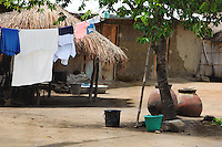 Ghana, Adaklu, Titikope, 2007. The packed earth of this village yard is kept impeccably neat by the homeowners.