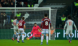 LONDON, ENGLAND - Monday, February 4, 2019: Liverpool's goalkeeper Alisson Becker is beaten as West Ham United score an equalising goal during the FA Premier League match between West Ham United FC and Liverpool FC at the London Stadium. The game ended in a 1-1 draw. (Pic by David Rawcliffe/Propaganda)