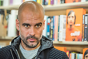 Johan Cruyff: My Turn (Pan Macmillan)book launch with Pep Guardiola (pictured), Jordi Cruyff (Johan's son) and Danny Cruyff (Johan's wife) at Waterstones Tottenham Court Road. Marking the publication of the long awaited autobiography <br /> of one of the world's most renowned footballers.