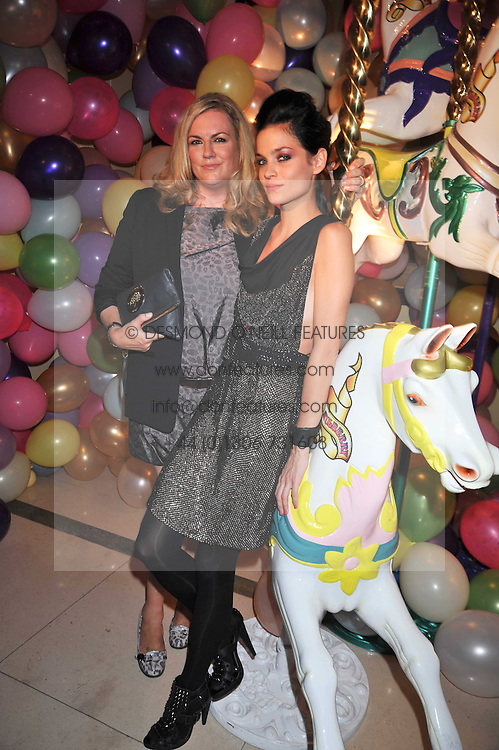 Left to right, EMMA HILL Creative Director at Mulberry and model LEIGH LEZARK at a party hosted by Mulberry during London fashion Week 2009 at Claridge's Hotel, Brook Street, London on 20th September 2009.