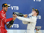 Valtteri Bottas of Mercedes AMG Petronas celebrates winning the Russian Formula One Grand Prix helped by Sebastian Vettel at Sochi Autodrom, Sochi, Russia.<br /> Picture by EXPA Pictures/Focus Images Ltd 07814482222<br /> 30/04/2017<br /> *** UK & IRELAND ONLY ***<br /> <br /> EXPA-EIB-170430-0231.jpg