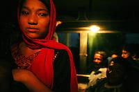A young girl rides the night bus to Kathmandu on June 9, 2006. (Photo/Scott Dalton)