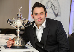 © Licensed to London News Pictures. 26/02/2013 London, UK. Reigning world snooker champion Ronnie O'Sullivan announces his return to snooker with the Championship Trophy at The London Hilton Metropole Hotel. The 37 year old pulled out of the 2012-13 season due to 'personal reasons' after playing just one match. He plans to defend his title with his first match at The Crucible, Sheffield in April this year..Photo credit : Simon Jacobs/LNP