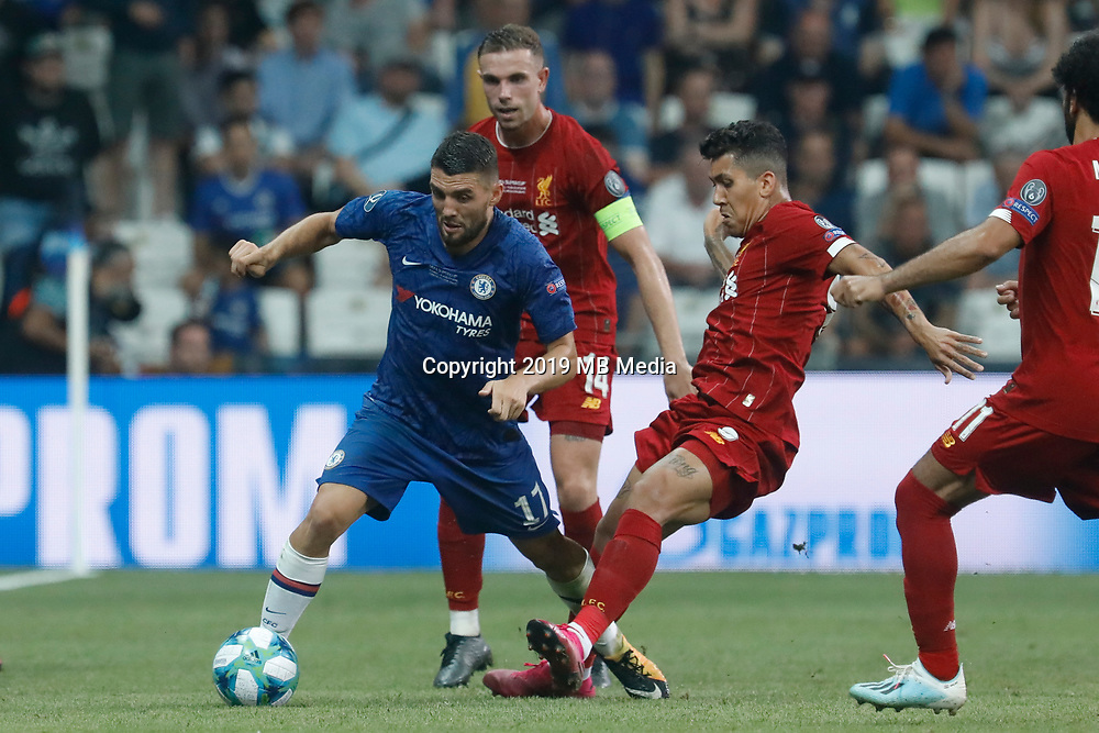 ISTANBUL, TURKEY - AUGUST 14: Roberto Firmino (R) and Jordan Henderson of Liverpool vie for the ball with Mateo Kovacic (L) of Chelsea during the UEFA Super Cup match between Liverpool and Chelsea at Vodafone Park on August 14, 2019 in Istanbul, Turkey. (Photo by MB Media/Getty Images)