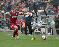 Milton Keynes Dons' Jason Banton and Bristol City's Joe Bryan challenge  - Photo mandatory by-line: Nigel Pitts-Drake/JMP - Tel: Mobile: 07966 386802 24/08/2013 - SPORT - FOOTBALL - Stadium MK - Milton Keynes - Milton Keynes Dons V Bristol City - Sky Bet League One