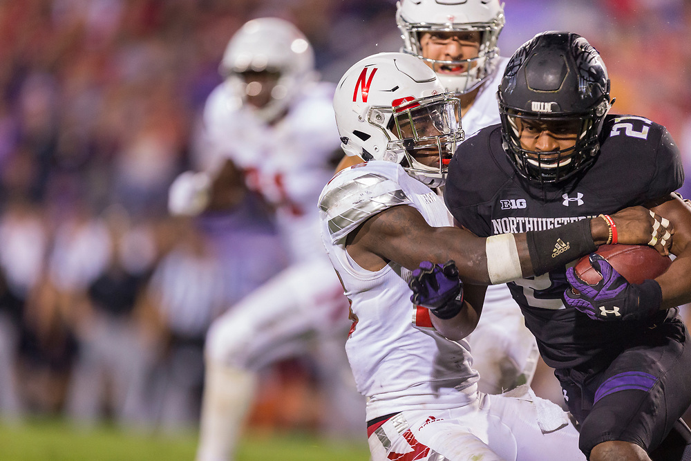 Justin Jackson #21 of the Northwestern Wildcats is tackled by Kieron Williams #26 of the Nebraska Cornhuskers during Nebraska's game 24-13 win over Northwestern at Ryan Field in Evanston, Ill. on Sept. 24, 2016. Photo by Aaron Babcock, Hail Varsity