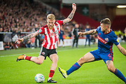 Oli McBurnie of Sheffield United and Max Power of Sunderland FC during the EFL Cup match between Sheffield United and Sunderland at Bramall Lane, Sheffield, England on 25 September 2019.