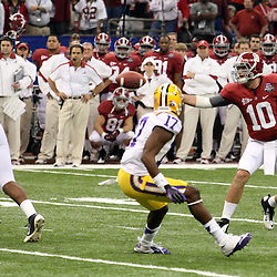 Jan 9, 2012; New Orleans, LA, USA; Alabama Crimson Tide quarterback A.J. McCarron (10) pitches the ball to tight end Chris Underwood (87) on a fake field goal as LSU Tigers cornerback Morris Claiborne (17) looks on during the first half of the 2012 BCS National Championship game at the Mercedes-Benz Superdome.  Mandatory Credit: Derick E. Hingle-US PRESSWIRE