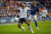 André Ayew of Swansea City is challenged by Joe Bennett of Cardiff City during the EFL Sky Bet Championship match between Cardiff City and Swansea City at the Cardiff City Stadium, Cardiff, Wales on 12 January 2020.