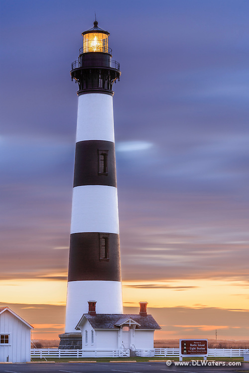 A long exposure of Bodie Island Lighthouse on the Outer Banks, reveals movement in the clouds at sunrise.
