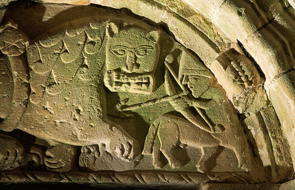 Tympanum above north door of Cormac's Chapel, Rock of Cashel. Norman centaur kills Celtic Christian lion. Co. Tipperary, Ireland