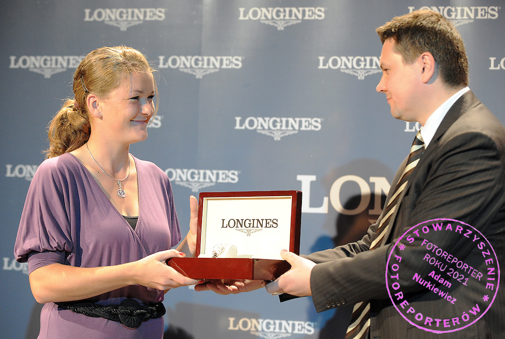 (L) TENNIS PLAYER AGNIESZKA RADWANSKA FROM POLAND & (R) LESZEK PILCH DURING SIGNING OFFICIAL AGREEMENT WITH LONGINES WATCHES IN POLSKIE RADIO HALL IN WARSAW, POLAND...WARSAW , POLAND , MAY 19, 2009..( PHOTO BY ADAM NURKIEWICZ / MEDIASPORT )