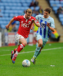 Bristol City's Wade Elliott battles for the ball with Coventry City's Shaun Miller  - Photo mandatory by-line: Joe Meredith/JMP - Mobile: 07966 386802 - 18/10/2014 - SPORT - Football - Coventry - Ricoh Arena - Bristol City v Coventry City - Sky Bet League One