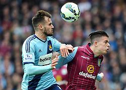 Aston Villa's Jack Grealish  battles for the high ball with West Ham United's Carl Jenkinson - Photo mandatory by-line: Joe Meredith/JMP - Mobile: 07966 386802 - 09/05/2015 - SPORT - Football - Birmingham - Villa Park - Aston Villa v West Ham United - Barclays Premier League