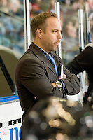 KELOWNA, CANADA, NOVEMBER 25: Todd Johnson, assistant coach of the Kootenay Ice stands on the bench as the Kootenay Ice visit the Kelowna Rockets  on November 25, 2011 at Prospera Place in Kelowna, British Columbia, Canada (Photo by Marissa Baecker/Shoot the Breeze) *** Local Caption *** Todd Johnson;
