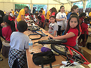Shadydale Elementary second- and third-graders assemble the bikes they received as a reward to improving their literacy skills.