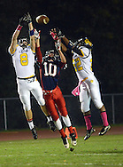 NEW HOPE, PA -  OCTOBER 25: New Hope Solebury's Danny Sutton (8) and Joseph Dwight (32) attempt to catch a pass as Jenkintown's Andres Madden (10) defends in the first half October 25, 2013 in New Hope, Pennsylvania.  (Photo by William Thomas Cain/Cain Images)
