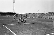 09/06/1963<br /> 06/09/1963<br /> 09 June 1963<br /> Soccer International: Ireland v Scotland at Dalymount Park Dublin. Ireland won the game 1-0 with a goal from Captain Noel Cantwell.  Noel Cantwell (centre)  blocked by Scotland's Billy McNeill in one of his attempts to score.