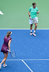 WUHAN, Sept. 28, 2018  Elise Mertens (L) of Belgium and Demi Schuurs of the Netherlands react during the doubles semifinal match against Shuko Aoyama of Japan and Lidziya Marozava of Belarus at the 2018 WTA Wuhan Open tennis tournament in Wuhan, central China's Hubei Province, on Sept. 28, 2018. Elise Mertens and Demi Schuurs won 2-1. (Credit Image: © Jiang Kehong/Xinhua via ZUMA Wire)