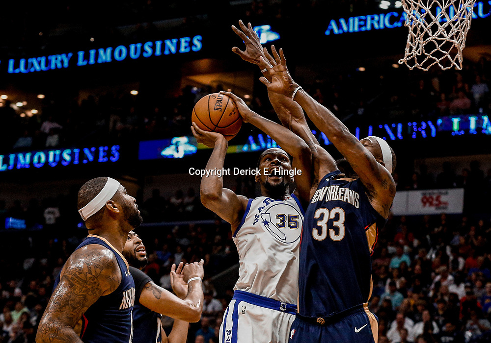 Oct 20, 2017; New Orleans, LA, USA; Golden State Warriors forward Kevin Durant (35) is defended by New Orleans Pelicans forward Dante Cunningham (33) and forward Anthony Davis (23) and forward DeMarcus Cousins (0) during the first quarter of a game at the Smoothie King Center. Mandatory Credit: Derick E. Hingle-USA TODAY Sports