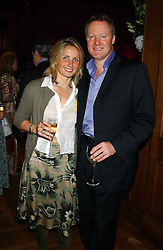 RORY BREMNER and his wife TESSA at a private view and auction of a collection of paintings, drawings and doodles by well known personalities to mark the Book launch of Ackroyd's Ark in Christie's, 8 King Street, St.James's, London on 20th September 2004 in aid of Tusk Trust.<br />