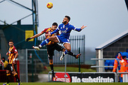 Bradford City midfielder Timothee Dieng (8) climbs in the air with Oldham Athletic forward Aaron Amadi-Holloway (10)  during the EFL Sky Bet League 1 match between Oldham Athletic and Bradford City at Boundary Park, Oldham, England on 28 January 2017. Photo by Simon Davies.