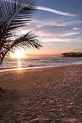 Sunrise over the ocean on a beach in Punta Cana, Dominican Republic.
