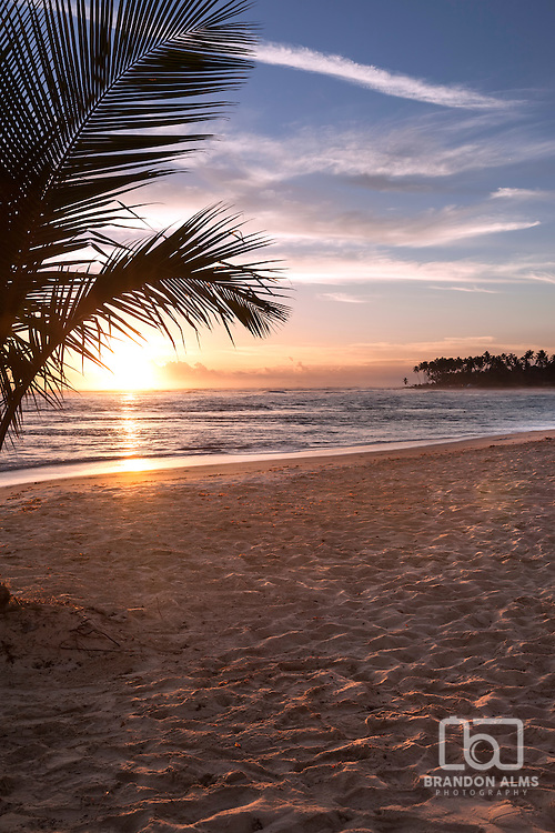 Sunrise over the ocean on a beach in Punta Cana, Dominican Republic.