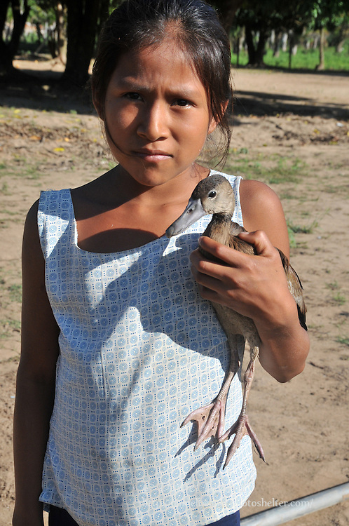 Yuracare girl holding a pet duck, near San Lorenzo, Beni, Bolivia