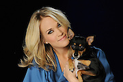 Nashville, TN, January 14, 2010 - Country star Carrie Underwood holds her dog Ace during the taping of a PSA for Pedigree.