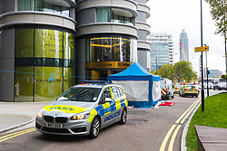 A police cordon surrounding a forensics tent remains in place outside The Corniche on the Albert Embankment in London after a window pane fell yesterday morning killing passing coach driver Mick Ferris. Albert Embankment, London, October 03 2018.