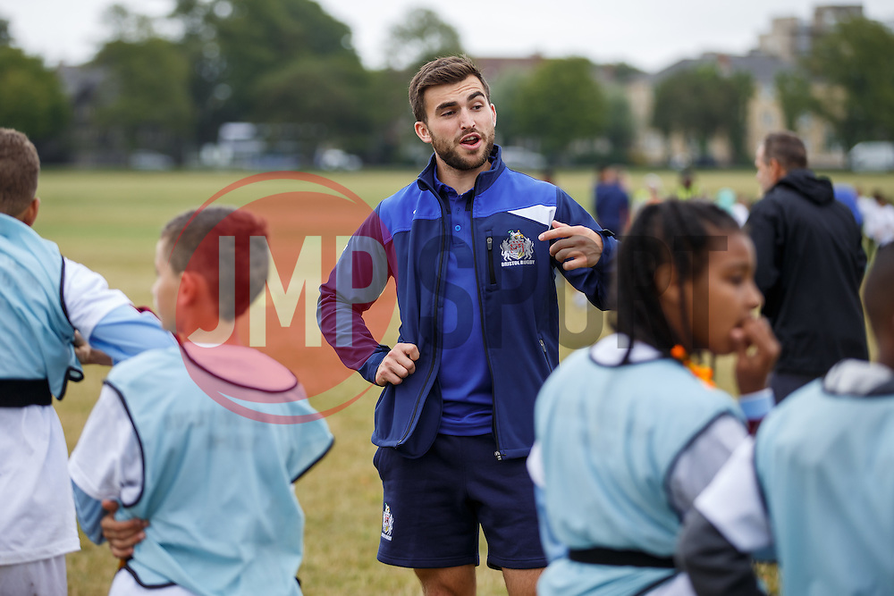 Craig Hampson of Bristol Rugby looks on as Local Junior Schools compete in a Tag Rugby Competion - Mandatory byline: Rogan Thomson/JMP - 07966 386802 - 14/07/2015 - SPORT - RUGBY UNION - Bristol, England - Durdham Downs -  Webb Ellis Cup visits Bristol as part of the 2015 Rugby World Cup Trophy Tour