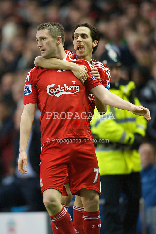 LIVERPOOL, ENGLAND - Friday, December 26, 2008: Liverpool's Robbie Keane celebrates scoring against Bolton Wanderers with team-mate Yossi Benayoun during the Premiership match at Anfield. (Photo by David Rawcliffe/Propaganda)