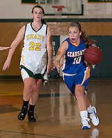 Anna Cahill of Kearsarge makes a fast break ahead of Kathryn Nadeau of Bishop Brady during varsity basketball action Monday evening.  (Karen Bobotas/for the Concord Monitor)