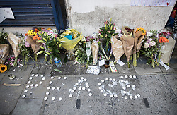 © Licensed to London News Pictures. 20/06/2017. London, UK. Floral tributes and candles spelling the word 'peace' are left in Whadcoat Street in Finsbury Park in north London where a van ploughed into a crowd near Finsbury Park Mosque.  One person has been killed and 10 people are injured. Darren Osborne, 47, from Cardiff, continues to be held on suspicion of attempted murder and alleged terror offences.  Photo credit: Peter Macdiarmid/LNP
