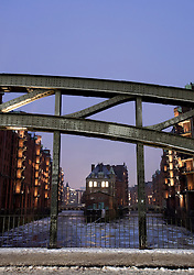 View of Wasserschloesschen  from the Poggenmuehlenbrueck during winter in Speicherstadt historic warehouse district in Hamburg Germany