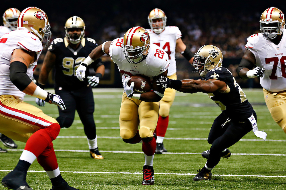 NEW ORLEANS, LA - NOVEMBER 9:   Carlos Hyde #28 of the San Francisco 49ers scores a touchdown in the first quarter of a game against the New Orleans Saints at Mercedes-Benz Superdome on November 9, 2014 in New Orleans, Louisiana.  (Photo by Wesley Hitt/Getty Images) *** Local Caption *** Carlos Hyde