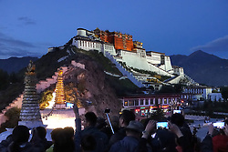 A picture made available on 19 September 2016 of tourists taking photos of the Potala Palace in Lhasa, Tibet Autonomous Region, China, 09 September 2016. The famous Potala Palace used to be the main residence of the Dalai Lama but is now a preserved as a museum and world heritage site.