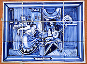 A ceramic tile painting celebrating Fado on the exterior of a home in Lisbon.