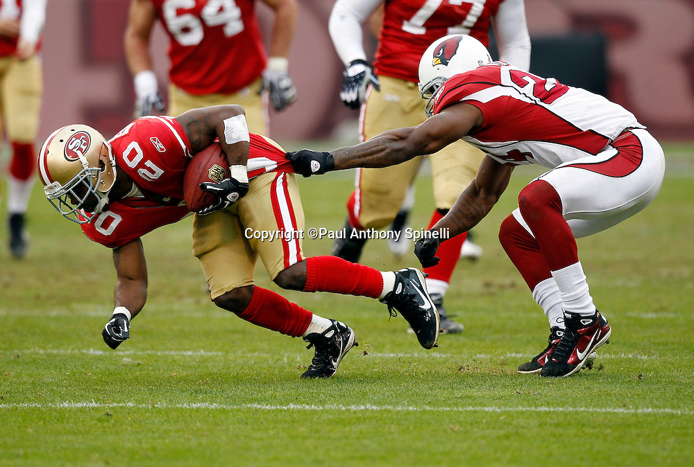 San Francisco 49ers running back Brian Westbrook (20) tries to break free from a jersey pulling tackle attempt by Arizona Cardinals safety Adrian Wilson (24) during the NFL week 17 football game against the Arizona Cardinals on Sunday, January 2, 2011 in San Francisco, California. The 49ers won the game 38-7. (©Paul Anthony Spinelli)