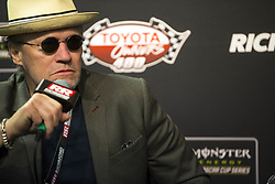 April 21, 2018 - Richmond, Virginia, United States of America - April 21, 2018 - Richmond, Virginia, USA: Michael Rooker talks wins media before the Toyota Owners 400 at Richmond Raceway in Richmond, Virginia. (Credit Image: © Stephen A. Arce/ASP via ZUMA Wire)