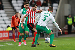 March 2, 2019 - Sunderland, England, United Kingdom - Sunderland's Lewis Morgan contests for the ball with Plymouth Argyle's Gary Sawyer during the Sky Bet League 1 match between Sunderland and Plymouth Argyle at the Stadium Of Light, Sunderland on Saturday 2nd March 2019. (Credit Image: © Mi News/NurPhoto via ZUMA Press)