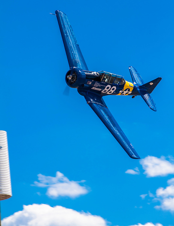 SNJ-5 flown close to the pylon by John Lohmar of Ft. Worth, Texas.  T-6 Gold Race, Sunday at Reno.