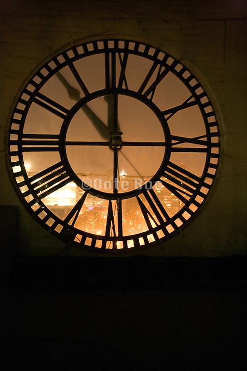 large clock at five minutes before twelve
