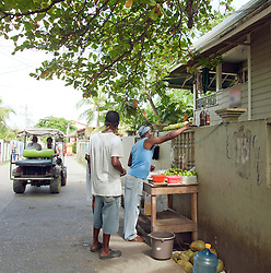 Daily life on the main street on the island of Utila.