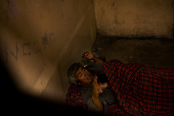 A man on the floor of a prison cell in Nogales.